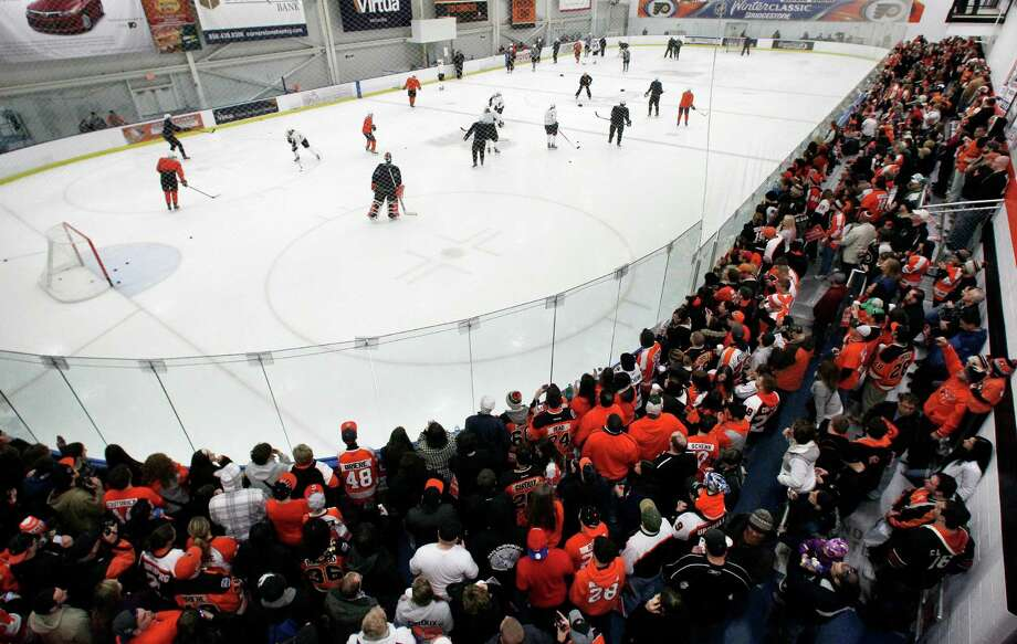A capacity crowd of Philadelphia Flyers fans fills the rink to capacity at the first practice session at the team's training camp Sunday, Jan. 13, 2013, in Voorhees, NJ. The Flyers, and other NHL teams, returned after a 113-day lockout ended with an settlement on a new collective bargaining agreement. (AP Photo/Tom Mihalek) Photo: Tom Mihalek