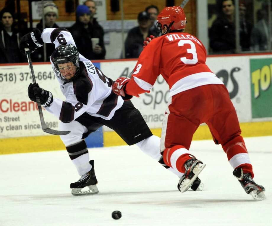 Union's Daniel Carr (9), left, charges the puck as Cornell's Reece Willcox (3) defends during their hockey game on Friday, Jan. 18, 2013, at Union College in Schenectady, N.Y. (Cindy Schultz / Times Union) Photo: Cindy Schultz / 00020774A