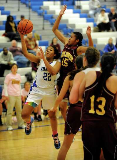 Shaker's Lyric Artis (22) puts up a shot against Colonie while be defended by Nicole Riddick (15) du