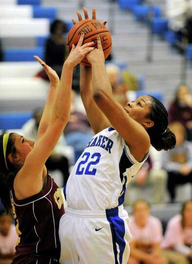 Colonie's Samantha Blum (4) and Shaker's Lyric Artis (22) battle for a rebound during their basketba