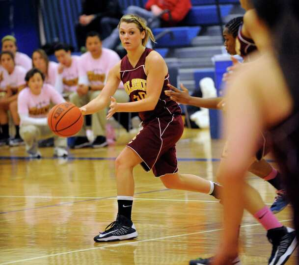 Colonie's Jaclyn Welch ,left, moves the ball against Shaker during their basketball game in Latham,