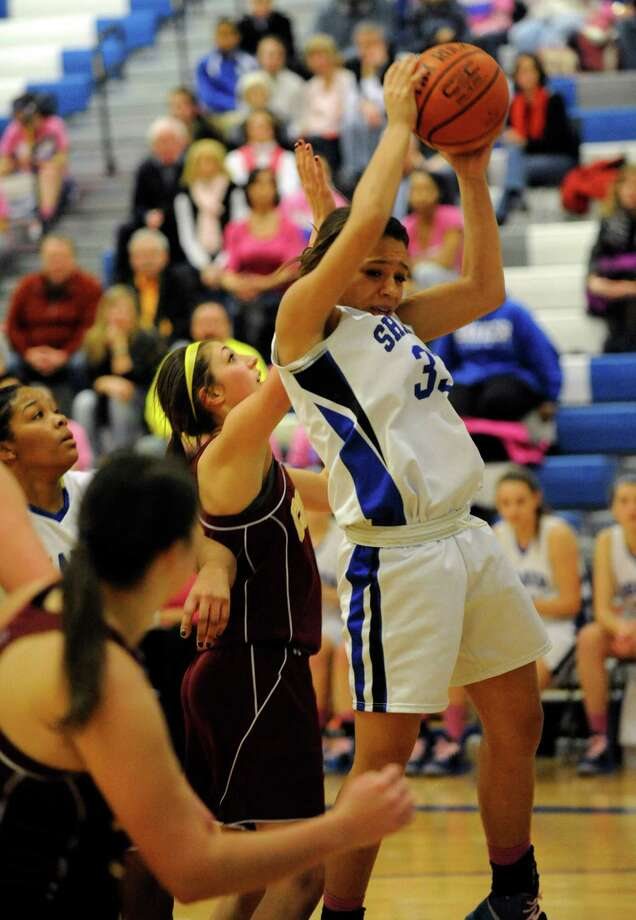 Shaker's Merrick Rowland (33) grabs a rebound against Colonie during their basketball game in Latham, N.Y., Friday, Jan.18, 2013. (Hans Pennink / Special to the Times Union) High School Sports Photo: Hans Pennink / Hans Pennink