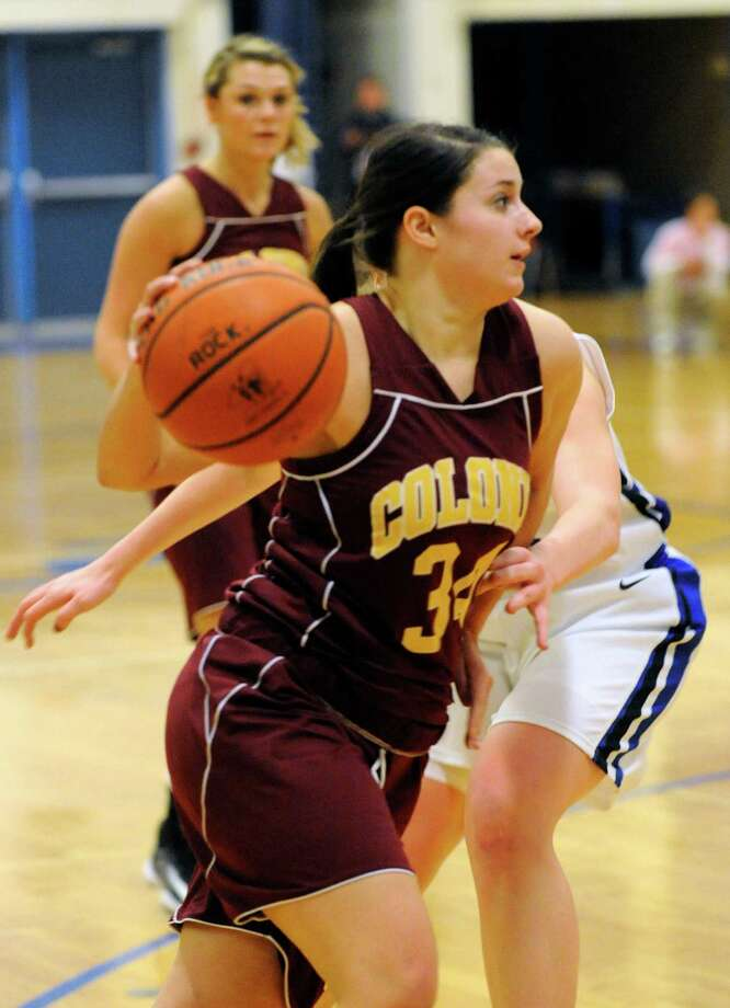Colonie's Kelsey Shadick (34) moves the ball against Shaker during their basketball game in Latham, N.Y., Friday, Jan.18, 2013. (Hans Pennink / Special to the Times Union) High School Sports Photo: Hans Pennink / Hans Pennink