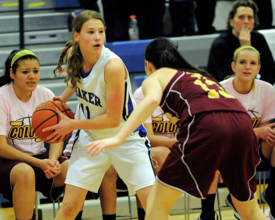 Shaker's Jenni Bara (11) is defneded by Colonie's Julia Dyer (13) during their basketball game in Latham, N.Y., Friday, Jan.18, 2013.(Hans Pennink / Special to the Times Union) High School Sports Photo: Hans Pennink / Hans Pennink