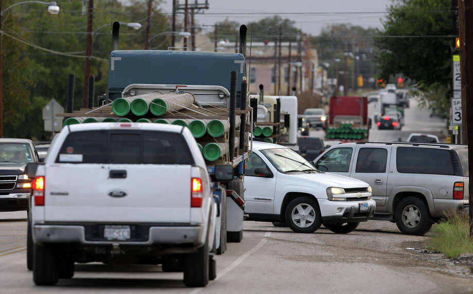 Traffic builds in Yorktown, in the Eagle Ford Shale formation area where heavy trucks are taking a toll on roads. The shale boom has also boosted traffic deaths. Photo: JOHN DAVENPORT, Jdavenport@express-news.net / SAN ANTONIO EXPRESS-NEWS (Photo can be sold to the public)