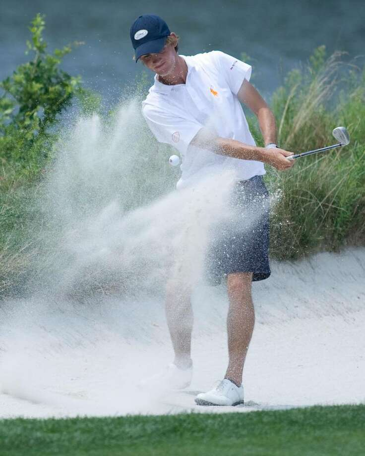 Chris Wiatr of Woodbury blasts out of the bunker to within two feet of the 12th hole during play in the AJGA Northeast Open tournament Tuesday at Richter Park Golf Course. August 2009 Photo: Barry Horn / The News-Times