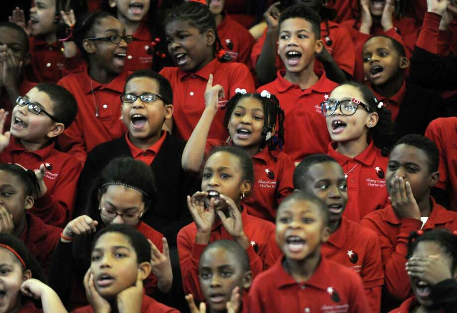 All students participate in a Martin Luther King chant during a Remembering and Celebrating Dr. Martin Luther King Jr. program at the Albany Community Charter School on Friday Jan.18,2013 in Albany, N.Y. (Michael P. Farrell/Times Union) Photo: Michael P. Farrell