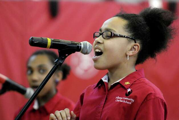 "Mailayah Boccanfuso joins members of the fifth grade choir sing the ""I Have a Dream"" song during a Remembering and Celebrating Dr. Martin Luther King Jr. program at the Albany Community Charter School on Friday Jan.18,2013 in Albany, N.Y. (Michael P. Farrell/Times Union) Photo: Michael P. Farrell"