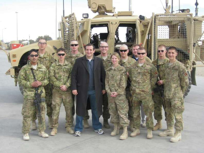 Sen. Ted Cruz poses with service members while traveling on his first congressional delegation trip