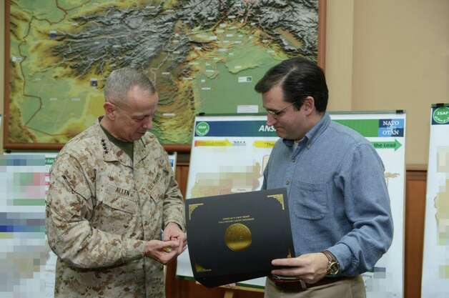 Sen. Ted Cruz receives a challenge coin from ISAF Commander Gen. John Allen (USMC).