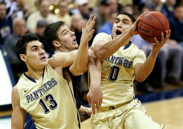 Pittsburgh's Steven Adams (13) and UConn's Tyler Olander, center, get tangled up as James Robinson (0) shoots during the first half of an NCAA college basketball game, Saturday, Jan. 19, 2013, in Pittsburgh. (AP Photo/Keith Srakocic)