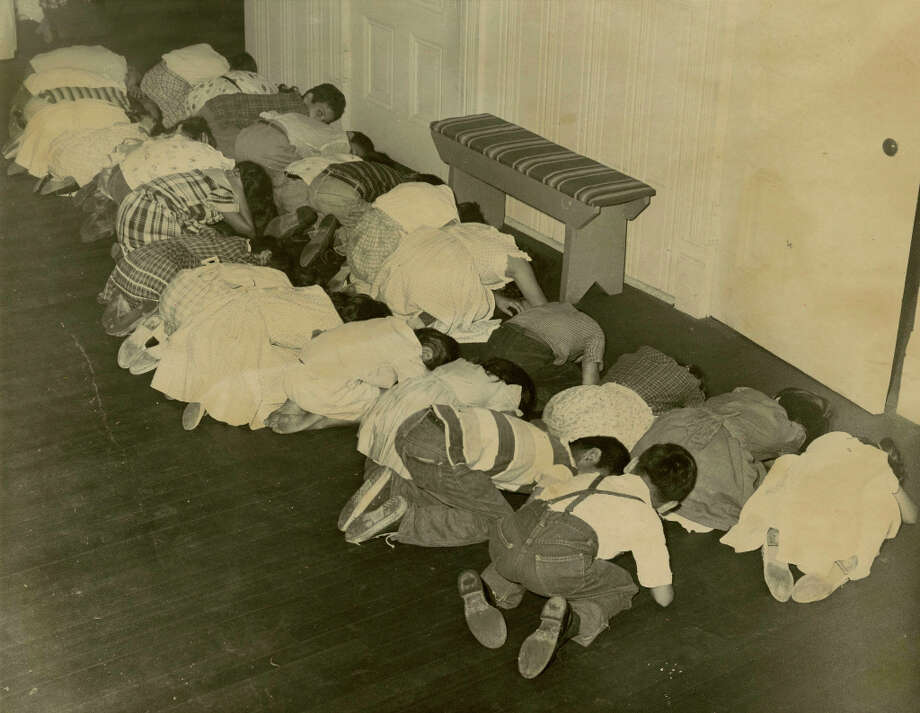 Students at Anson Jones Elementary take part in a disaster drill, September 1959. Photo: Chronicle Photo / Houston Chronicle Library Scan
