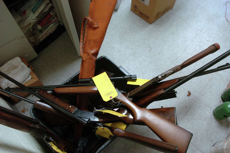 Guns collected by the Stamford Police at the Turn of River Firehouse during a buyback event in Stamford, Conn., Jan. 19, 2013. Roughly 15 guns were collected during the event including shotguns, rifles and handguns. Photo: Keelin Daly / Stamford Advocate Freelance