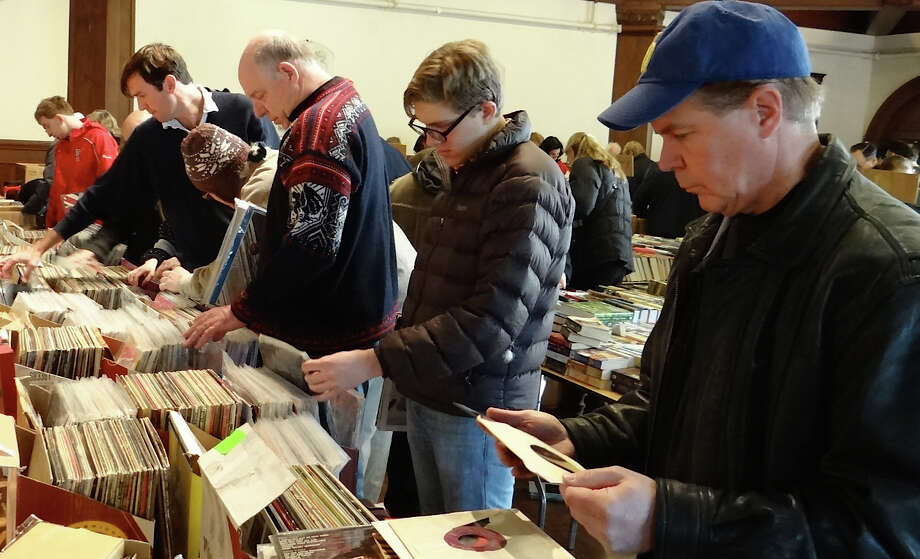 Books were not the only thing on offer Saturday at the Pequot Library's Mid-Winter Book Sale. Here, browsers comb through vinyl records on sale.  FAIRFIELD CITIZEN, CT 1/19/13 Photo: Mike Lauterborn / Fairfield Citizen contributed