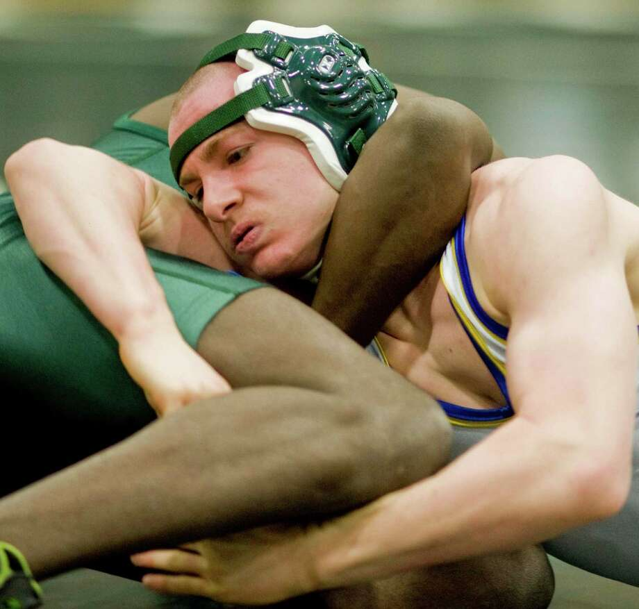 Newtown High School's Mike Long tries to work out of a hold in the 132lb. class in the wrestling tournament at New Milford High School. Saturday, Jan. 19, 2013 Photo: Scott Mullin / The News-Times Freelance