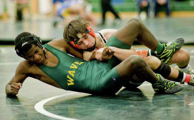 New Milford High School's Minjani Smith tries to pull away from Ridgefield High School's Jack Boscia in the 132lb. class during the wrestling tournament at New Milford High School. Saturday, Jan. 19, 2013 Photo: Scott Mullin / The News-Times Freelance