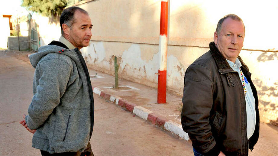 Two British hostages Peter, left, and Alan, right, (no  family name available), are seen after being released, in a street of Ain  Amenas, near the gas plant where they have been kidnapped by Islamic militants,  Saturday, Jan. 19, 2013. Algeria's special forces stormed the natural gas  complex in the middle of the Sahara desert in a final assault Saturday, killing  11 militants, but not before they in turn killed seven hostages, the state news  agency reported.(AP Photo/Anis Belghoul)