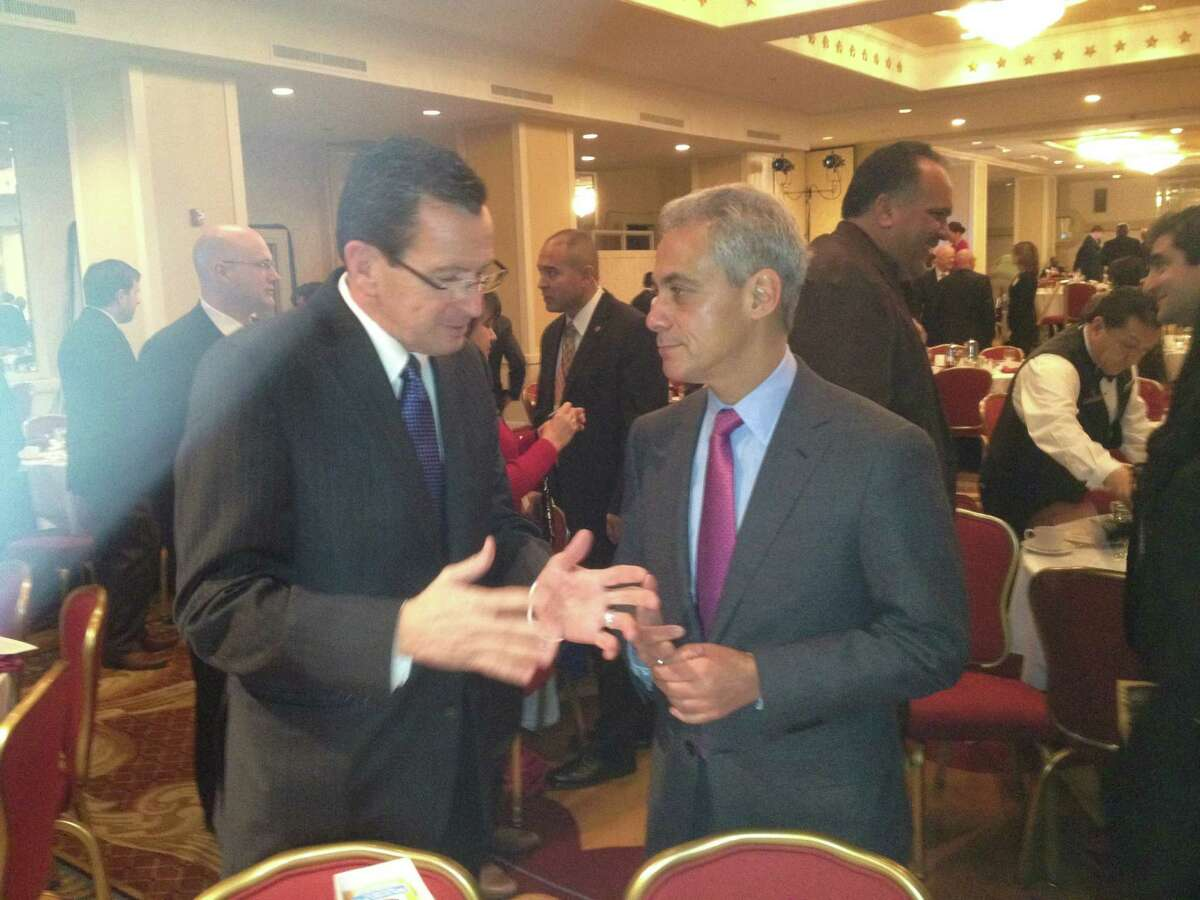 Connecticut Gov. Dannel P. Malloy chats with Chicago Mayor Rahm Emanuel at the winter meeting of the U.S. Conference of Mayors in Washington, D.C. Saturday. Malloy sought to rally the group behind his campaign against gun violence.