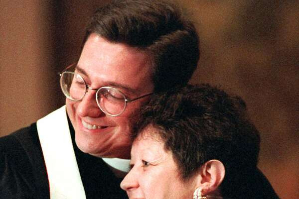 "Norma McCorvey, ""Jane Roe"" in the 1973 decision, in 1995 came out against abortion. Here she's embraced by the Rev. Robert Schenck before a protest in 1996."