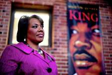 "ADVANCE FOR MONDAY, JAN. 21, 2013 AND THEREAFTER - In this Tuesday, Jan. 8, 2013 photo, Bernice King stands in the King Center next to a banner hanging in memory of her father, Dr. Martin Luther King Jr., in Atlanta. One of her father's quotes has been cited as one of America's essential ideals, its language suggestive of a constitutional amendment on equality: ""I have a dream that my four little children will one day live in a nation where they will not be judged by the color of their skin but by the content of their character."" Yet today, 50 years after the Rev. Martin Luther King Jr.'s monumental statement, there is considerable disagreement over what this quote means when it comes to affirmative action and other measures aimed at helping the disadvantaged. (AP Photo/David Goldman)"