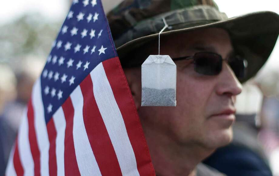 Tea bags hang from the hat of Steve Wandtke during a Guns Across America rally at the state capitol, Saturday, Jan. 19, 2013, in Austin. Texas officials opposed to new federal gun control proposals plan to speak on the steps of the state Capitol during a pro-Second Amendment rally. The event is one of many rallies planned across the country Saturday. They come four days after President Barack Obama unveiled a sweeping plan to curb gun violence. Photo: Eric Gay, Associated Press / AP