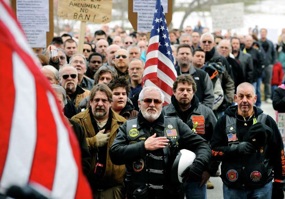 "Gun rights supporters rally at the Capitol in Hartford, Conn., Saturday, Jan. 19, 2013.  The rally, dubbed, ""Guns Across America"", at Connecticut's state Capitol and state capitol buildings across the country to raise concerns about possible new gun legislation that could affect gun owners' rights in the wake of the Dec. 14 school shooting at Sandy Hook Elementary School in Newtown. Photo: Jessica Hill, Associated Press / FR125654 AP"