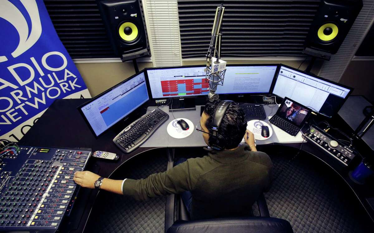 When Alex Hernández is on the air from his studio near Alamo Heights and chatting with sidekick Marta Adriana, listeners likely are unaware that he's seeing her on a computer screen. She's actually in Mexico City.
