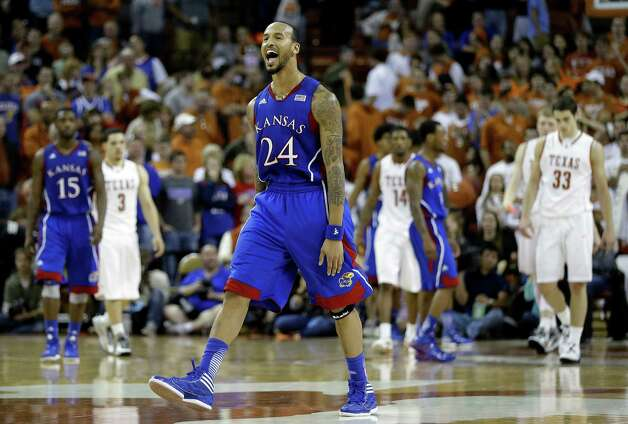 Kansas' Travis Releford (24) reacts as his team defeated Texas 64-59  in an NCAA college basketball game, Saturday, Jan. 19, 2013, in Austin, Texas.  (AP Photo/Eric Gay) Photo: Eric Gay, Associated Press / AP