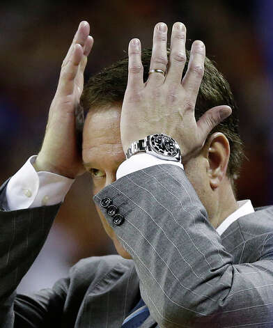 Kansas coach Bill Self grabs his head during the second half of an NCAA college basketball game against Texas, Saturday, Jan. 19, 2013, in Austin, Texas. Kansas won 64-59. (AP Photo/Eric Gay) Photo: Eric Gay, Associated Press / AP