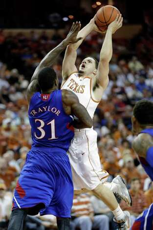 Texas' Javan Felix, right, shoots over Kansas' Jamari Traylor (31) during the first half of an NCAA college basketball game, Saturday, Jan. 19, 2013, in Austin, Texas. (AP Photo/Eric Gay) Photo: Eric Gay, Associated Press / AP