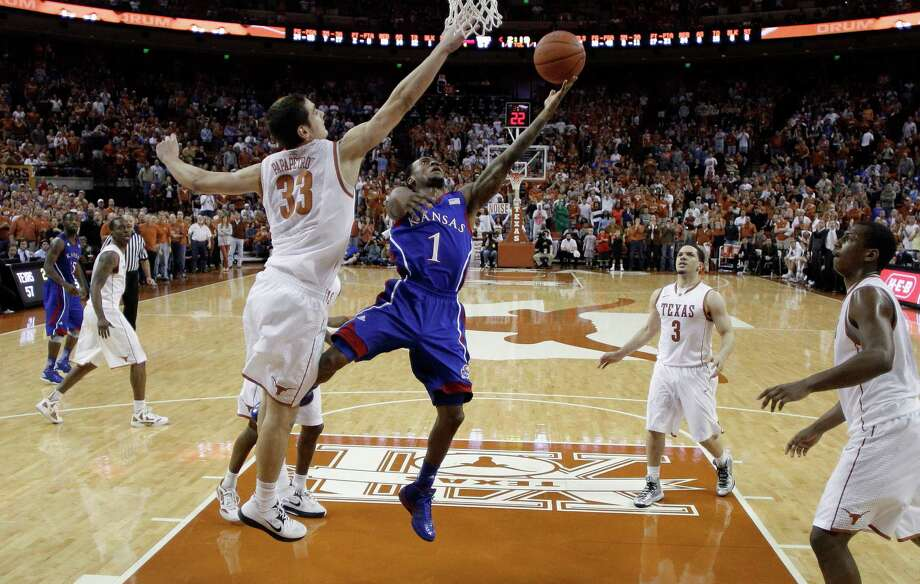 Naadir Tharpe (1) shoots next to Texas' Ioannis Papapetrou (33) during the second half of an NCAA college basketball game, Saturday, Jan. 19, 2013, in Austin, Texas. Kansas won 64-59. (AP Photo/Eric Gay) Photo: Eric Gay, Associated Press / AP
