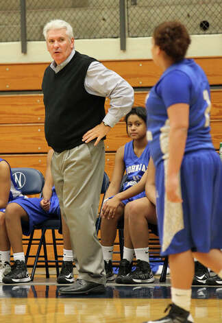 Jay coach Mike Floyd calmly guides his team against Stevens during girls basketball at Paul Taylor Fieldhouse on Saturday, Jan. 19, 2013. Jay defeated Stevens in overtime, 51-47. Photo: Kin Man Hui, Express-News / © 2012 San Antonio Express-News