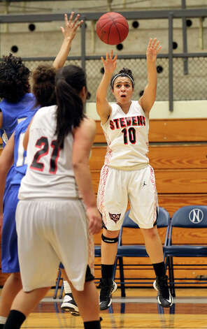 Stevens' Samantha Washington (10) attempts a shot against Jay during girls basketball at Paul Taylor Fieldhouse on Saturday, Jan. 19, 2013. Jay defeated Stevens in overtime, 51-47. Photo: Kin Man Hui, Express-News / © 2012 San Antonio Express-News
