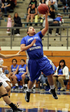 Jays' Destiny Amezquita (02) goes for two against Stevens during girls basketball at Paul Taylor Fieldhouse on Saturday, Jan. 19, 2013. Jay defeated Stevens in overtime, 51-47. Photo: Kin Man Hui, Express-News / © 2012 San Antonio Express-News