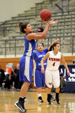 Jays' Katelyn McCullar (15) takes a shot attempt against Stevens during girls basketball at Paul Taylor Fieldhouse on Saturday, Jan. 19, 2013. Jay defeated Stevens in overtime, 51-47. Photo: Kin Man Hui, Express-News / © 2012 San Antonio Express-News
