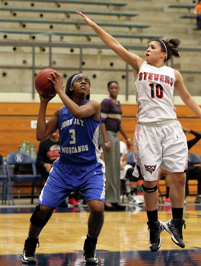Jays' Aleeya Harris (03) attempts a shot against Stevens' Samantha Washington (10) during girls basketball at Paul Taylor Fieldhouse on Saturday, Jan. 19, 2013. Jay defeated Stevens in overtime, 51-47. Photo: Kin Man Hui, Express-News / © 2012 San Antonio Express-News
