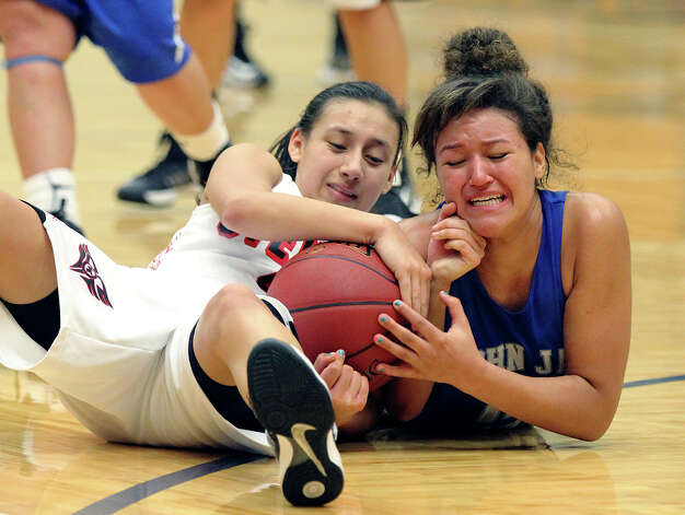 Stevens' Julia Rendon (left) struggles with Jay's Katelyn McCullar (right) for possession of the ball during girls basketball at Paul Taylor Fieldhouse on Saturday, Jan. 19, 2013. Jay defeated Stevens in overtime, 51-47. Photo: Kin Man Hui, Express-News / © 2012 San Antonio Express-News