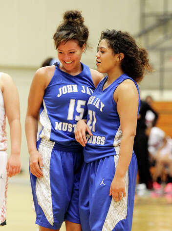 Jays' Katelyn McCullar (15) smiles as she receives encouragement from teammate Brittany Leonard (21) after McCullar dove for a loose ball against Stevens during girls basketball at Paul Taylor Fieldhouse on Saturday, Jan. 19, 2013. Jay defeated Stevens in overtime, 51-47. Photo: Kin Man Hui, Express-News / © 2012 San Antonio Express-News