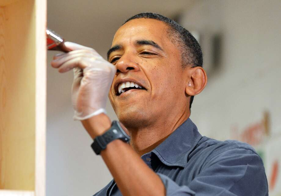 US President Barack Obama paints a bookshelf at Burrville Elementary School during Day of Service on January 19, 2013 in Washington DC, as part of the 57th Presidential Inauguration. Americans across the country participate in service projects in their communities to celebrate the legacy of civil rights leader Dr. Martin Luther King, Jr. The holiday honoring King will be observed on January 21, the day of the second inauguration of US President Barack Obama and Vice President Biden. Photo: JEWEL SAMAD, AFP/Getty Images / AFP