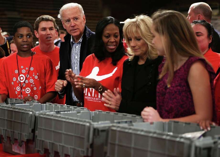 U.S. Vice President Joseph Biden (3rd L) and his wife Jill Biden (2nd R) participate during a Unite America in Service event on the National Day of Service as part of the 57th Presidential Inauguration January 19, 2013 at the DC Armory in Washington, DC. Vice President Biden and his family joined volunteers to pack care kits filled with necessities for deployed U.S. Service Members, Wounded Warriors, Veterans and First Responders. Photo: Alex Wong, Getty Images / 2013 Getty Images