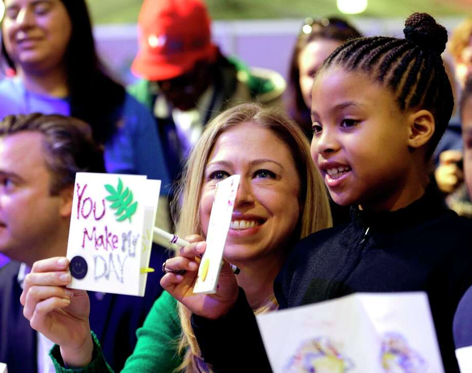 National Day of Service Honorary Chair, Chelsea Clinton, left and Addison Rose, 8, of Washington, display the cards they made as part of the National Day of Service project on the National Mall Saturday, Jan. 19, 2013, in Washington. The two made cards for the Sunshine Mail Foundation that sends the cards along with care packages to the ill and disadvantaged people. Photo: Steve Helber, Associated Press / AP