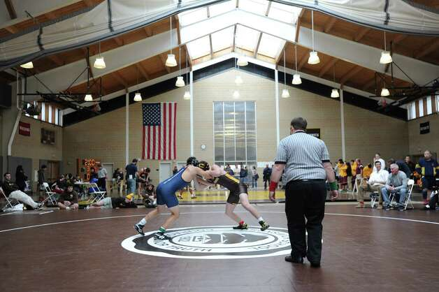 At right, Connor Kupersmith of Brunswick goes up against Tristan Kagan of Hotchkiss in a 152 pound match during the Brunswick Invitational Wrestling Tournament at the school in Greenwich, Saturday, Jan. 19, 2013. Photo: Bob Luckey / Greenwich Time