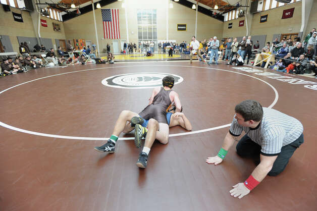 Top, Connor Kupersmith of Brunswick pins Tristan Kagan of Hotchkiss to win in a 152 pound match during the Brunswick Invitational Wrestling Tournament at the school in Greenwich, Saturday, Jan. 19, 2013. Photo: Bob Luckey / Greenwich Time