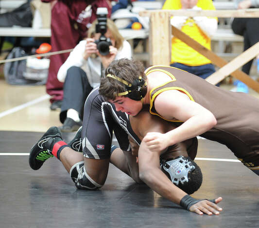 Top, Lucas Bell of Brunswick breaks free of a hold by Elijah Ngbokoli of Hackley in 152 pound match during the Brunswick Invitational Wrestling Tournament at the school in Greenwich, Saturday, Jan. 19, 2013. Photo: Bob Luckey / Greenwich Time