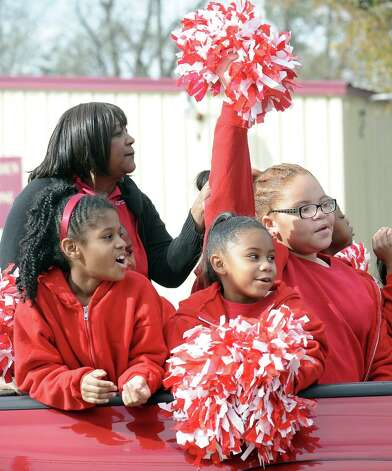 The Blanchette Elementary cheerleaders ride  during the Martin Luther King, Jr. parade on Highland Avenue in Beaumont on Saturday, January, 19, 2013. Photo taken: Randy Edwards/The Enterprise Photo: Randy Edwards