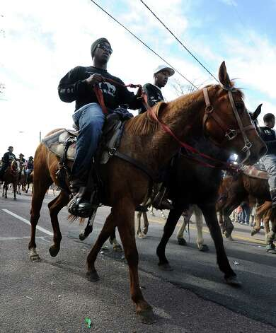 From horses to Harleys, supporters marched, rode, and danced their way down the street during the Martin Luther King, Jr. parade in Beaumont on Saturday, January, 19, 2013. Photo taken: Randy Edwards/The Enterprise