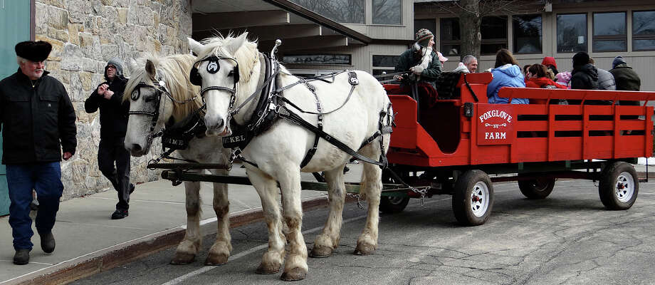 Horse-and-wagon rides were featured at Winterfest sponsored Saturday at Earthplace. WESTPORT NEWS, CT 1/19/13 Photo: Mike Lauterborn / Westport News contributed