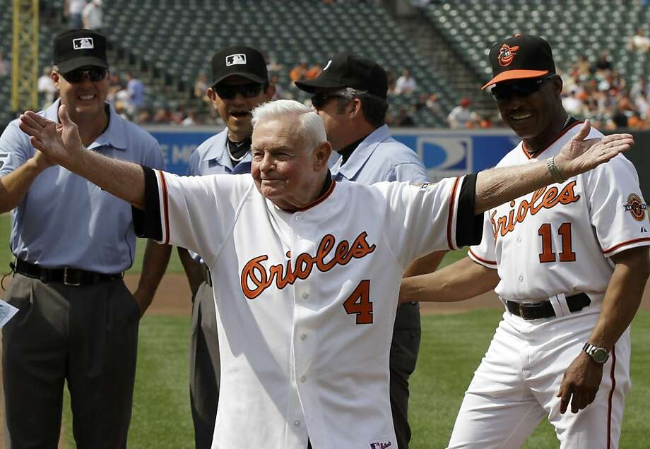 Former Orioles manager Earl Weaver waves after taking the lineup card out before the start of a game between Baltimore and Washington at Oriole Park. Photo: Rob Carr, Associated Press
