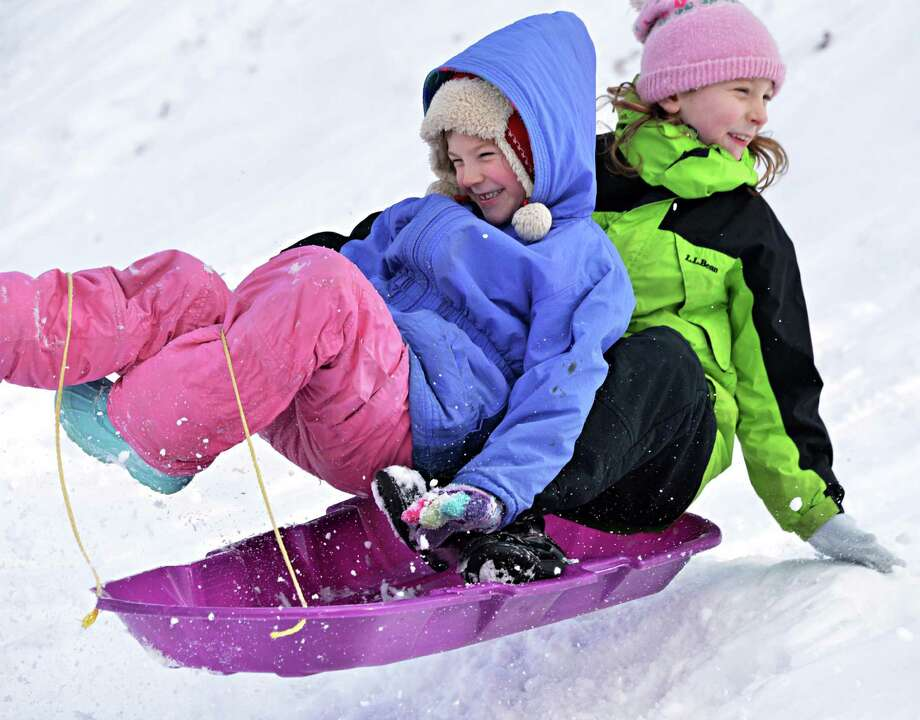 Grace, 6, left, and Anna Ferguson, 7 of Hoosick catch some air sledding during the 28th Annual Winter Festival at Grafton Lakes State Park Saturday Jan. 19, 2013.  (John Carl D'Annibale / Times Union) Photo: John Carl D'Annibale / 00020784A