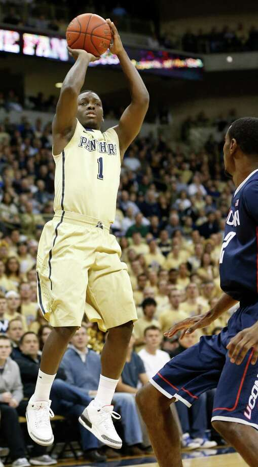 Pittsburgh's Tray Woodall (1) tries a shot in front of Connecticut's DeAndre Daniels (2) during the first half of an NCAA college basketball game, Saturday, Jan. 19, 2013, in Pittsburgh. Pittsburgh won 69-61.(AP Photo/Keith Srakocic) Photo: Keith Srakocic, Associated Press / AP